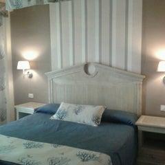 Photo taken at Oasis Golf Resort Hotel Tenerife by Sara R. on 8/11/2012