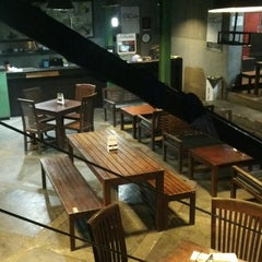 Photo taken at ZOE Café & Library by Heru T. on 3/21/2014