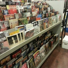 Photo taken at Ash Avenue Comics and Books by Brandi M. on 7/20/2013
