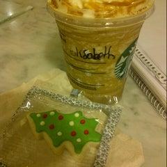 Photo taken at Starbucks by Lissy B. on 12/3/2012