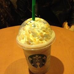 Photo taken at Starbucks by Marília D. on 7/5/2013