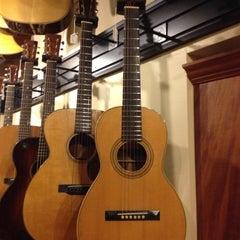 Photo taken at Gruhn Guitars by Doug C. on 11/15/2012