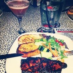 Photo taken at Gaslamp Strip Club Restaurant by Patricia Yuli S. on 8/25/2014
