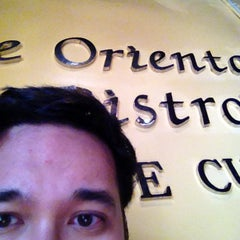 Photo taken at Le Oriental Bistro by Robert H. on 2/22/2014