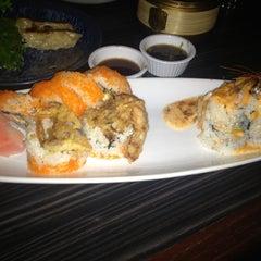 Photo taken at Sushi Koji by Romy P. on 1/23/2013