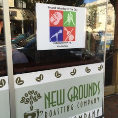 Photo taken at New Grounds Roasting Company by T S. on 7/11/2015