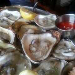 Photo taken at Biggie's Restaurant Raw Bar Tavern by ItaliThai D. on 12/5/2012