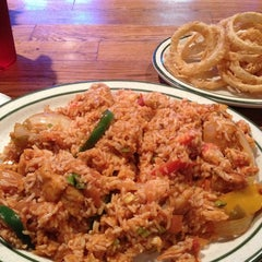 Photo taken at Floyds Cajun Seafood And Texas Steakhouse by Paul M. on 4/10/2013
