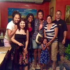 Photo taken at Jawaiian Irie Jerk Restaurant by Isabella K. on 5/19/2015