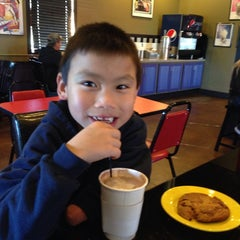 Photo taken at Mokas Coffee by Andy S. on 11/9/2013