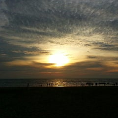 Photo taken at Pantai Saujana (Pantai Batu Empat) by Lisa S. on 1/6/2013