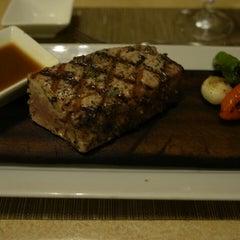 Photo taken at Norio's Japanese Steakhouse & Sushi Bar by Kenji K. on 3/25/2013