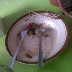Photo taken at Warung Pokwe Bu Trini by Dian P. on 11/5/2012