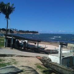 Photo taken at Praia de Itapuã by Rosane F. on 5/6/2013