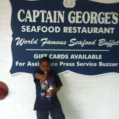 Photo taken at Captain George's Seafood Buffet by Kim F. on 3/21/2013