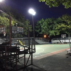 Photo taken at Rucker Park Basketball Courts by Jason W. on 10/4/2015