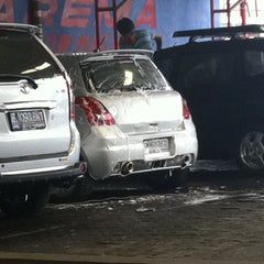 Photo taken at Arema Car Wash by Florencia V. on 10/28/2012