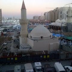 Photo taken at Masjid Abu Bakar, Madinah by Fuad F. on 11/25/2012