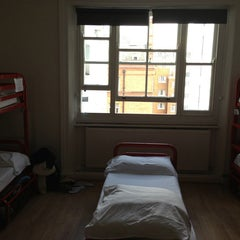 Photo taken at Astor Hyde Park Hostel by Dason C. on 3/14/2013