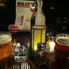 Photo taken at Gilly's by Ginger H. on 1/11/2013
