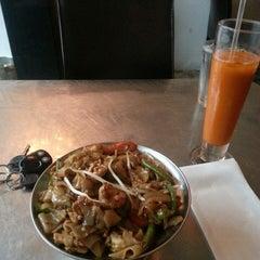 Photo taken at EAT = Authentic Thai Kitchen by Mimi O. on 7/12/2013