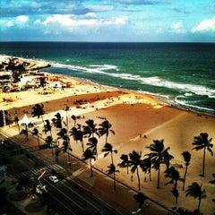 Photo taken at Praia do Pina by Gregorio R. on 10/18/2013