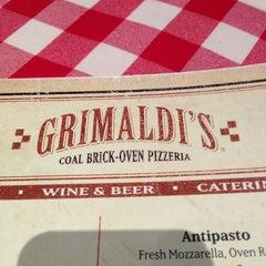 Photo taken at Grimaldi's by Jarrett S. on 12/31/2012