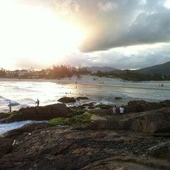 Photo taken at Praia da Ferrugem by Alexandre O. on 1/22/2013