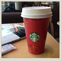 Photo taken at Starbucks by Chotiros N. on 12/20/2013