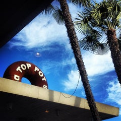 Photo taken at Top Pot Doughnuts by Will C. on 11/24/2012