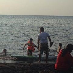 Photo taken at Pantai Penimbangan by Dâyū Ade J. on 5/6/2015
