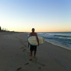 Photo taken at Scarborough Beach by Michelle S. on 12/24/2012