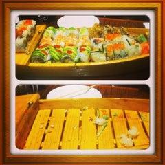 Photo taken at Tasu Asian Bistro Sushi & Bar by Chris F. on 4/6/2013