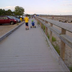 Photo taken at Silver Sands State Park Boardwalk by Maya B. on 8/9/2014