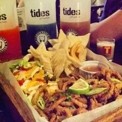 Photo taken at Tides Grill & Bistro by Ada 💋 on 7/26/2015