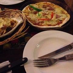 Photo taken at Cafe Asix by Anton K. on 10/18/2014