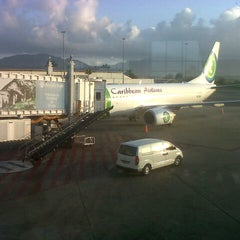 Photo taken at Piarco International Airport (POS) by Carlos G. on 3/9/2013