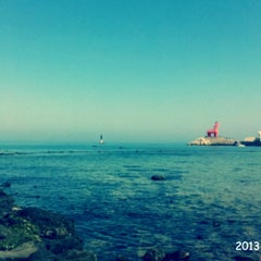Photo taken at 이호테우해변 (Iho Taewu Beach) by Summer K. on 5/14/2013
