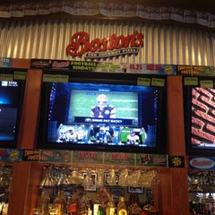Photo taken at Boston's Restaurant & Sports Bar by Kelly G. on 12/9/2012