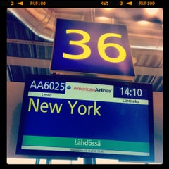 Photo taken at Gate 36 by Alexei C. on 10/10/2012