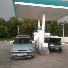 Photo taken at PETRONAS Station by Remy A. on 10/27/2012