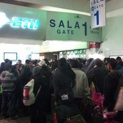 Photo taken at Sala/Gate 1 by Christian A. on 12/22/2012