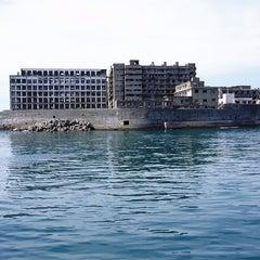 Photo taken at 端島 (軍艦島) Hashima (Gunkanjima) Island by Taben N. on 10/27/2012