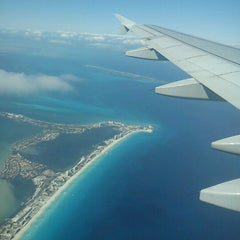 Photo taken at Aeropuerto Internacional De Cancún (CUN) by Mauricio D. on 3/3/2013