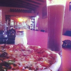 Photo taken at Old Mission Brewery by Joana H. on 11/24/2012