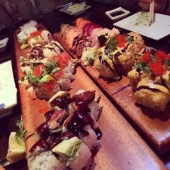 Photo taken at Okura Robata Sushi Bar and Grill by Matthew P. on 11/12/2014