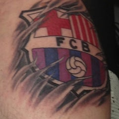Photo taken at Inkstop Tattoo by Jorge C. on 12/24/2012