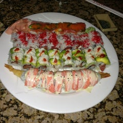 Photo taken at Tasu Asian Bistro Sushi & Bar by Josh L. on 7/2/2013