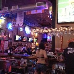 Photo taken at Bikinis Sports Bar & Grill by Maurice H. on 11/26/2012