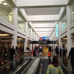 Photo taken at Miami International Airport (MIA) by Vivion S. on 7/5/2013